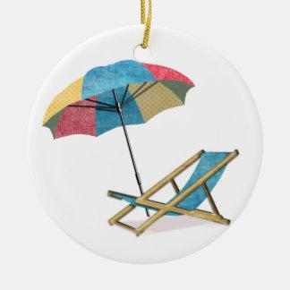Silla y paraguas de playa ornato