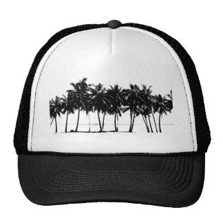 Silueta blanca negra de las palmeras gorras