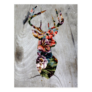 Silueta floral de la cabeza de los ciervos del postal