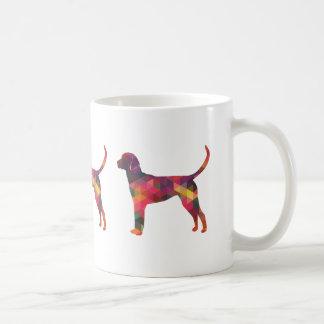 Silueta geométrica del perro del modelo del taza de café
