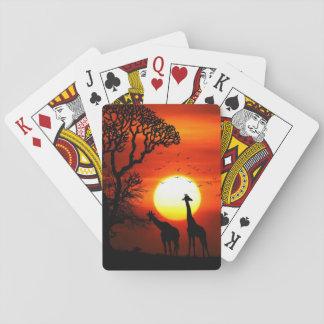 Siluetas africanas de la jirafa de la puesta del baraja de cartas