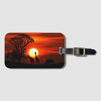 Siluetas africanas del animal de la puesta del sol etiqueta para maletas