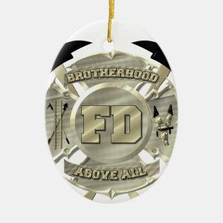 Símbolo de la fraternidad del bombero del oro adorno navideño ovalado de cerámica