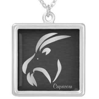 Símbolo de plata del zodiaco del Capricornio Joyerias