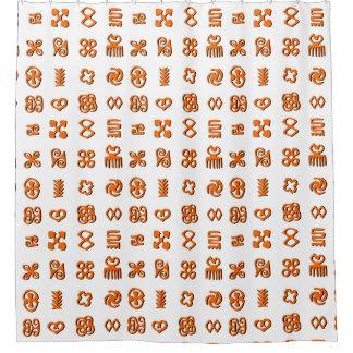 Símbolos de Adinkra en naranja y negro
