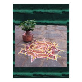 Símbolos indios del boda del rangoli de la cruz postal