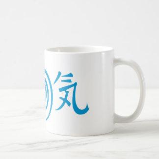 Símbolos té del poder de Reiki y taza de café