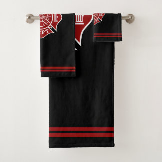 Sistemas de las toallas de baño con la cruz