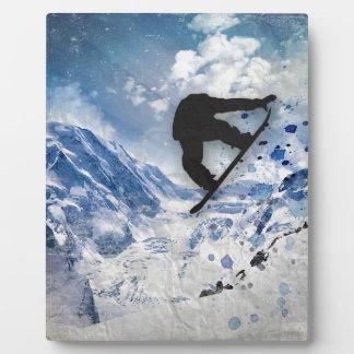 Snowboarder en vuelo placa expositora