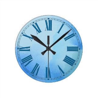 Sombras que fluyen del efecto azul de la acuarela reloj redondo mediano