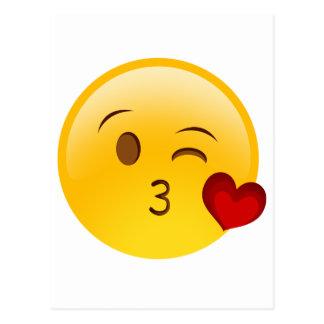 Sople a un pegatina del emoji del beso postal
