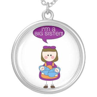 soy una hermana grande (los hermanos gemelos) colgante redondo