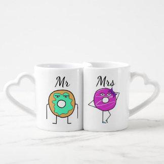 Sr. y señora tazas del buñuelo