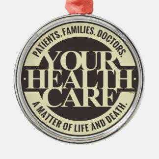 Su atención sanitaria adorno navideño redondo de metal