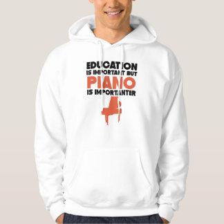 Sudadera La educación es importante pero el piano es