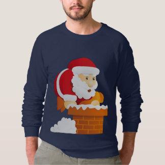 Sudadera Santa que se escabulle abajo de la chimenea en la