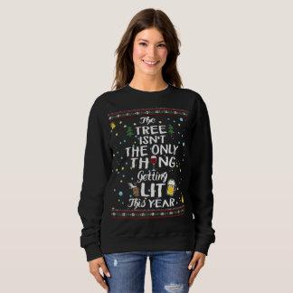 Suéter feo de consumición del navidad