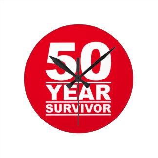 superviviente de 50 años reloj redondo mediano