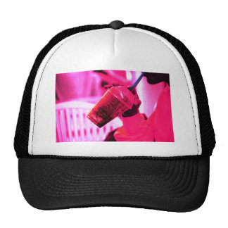 Surreal image of young woman drinking ice drink wi gorra