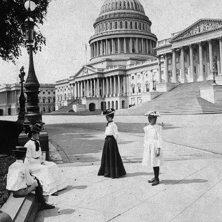 Exterior of the Capitol building with women