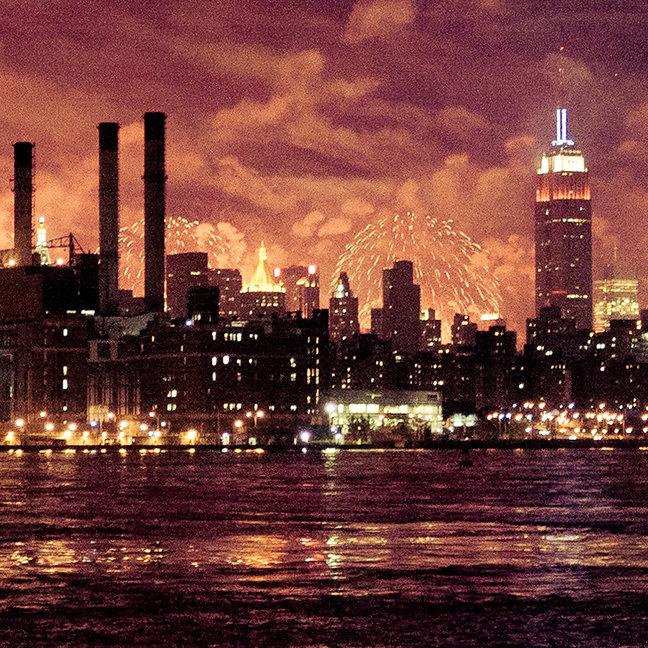 Fourth of July Fireworks behind Manhattan