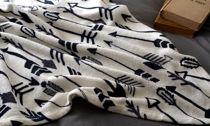 Miles de diseños de mantas en Zazzle