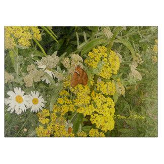 Tabla de cortar de las flores de mariposa