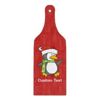 Tabla De Cortar Pingüino del navidad que camina en nieve