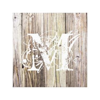 Tableros de madera rústicos con el monograma lienzo