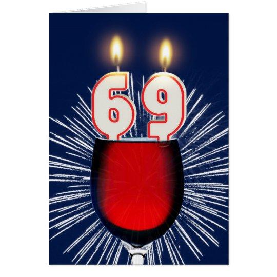 Tarjeta 69.o Cumpleaños con el vino y las velas