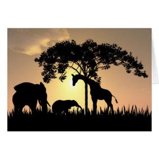 Tarjeta africana de la puesta del sol del safari