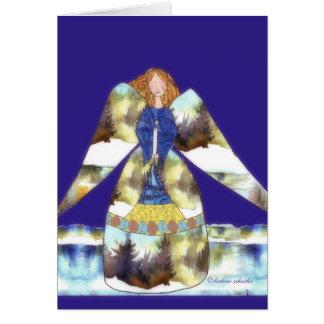 Tarjeta ángel con la vela, blackground azul