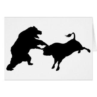 Tarjeta Bull contra concepto de la silueta del oso