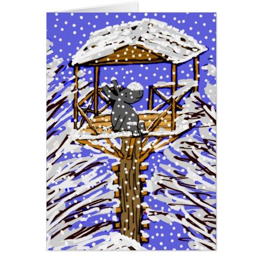 Tarjeta burro en casa del árbol en nieve