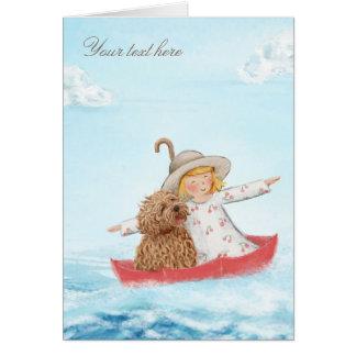 Tarjeta Chica y perro con el paraguas en el mar