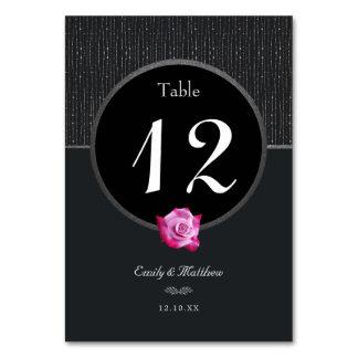 Tarjeta color de rosa rosada atractiva de la tabla