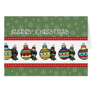 Tarjeta colorida de las Felices Navidad de los orn