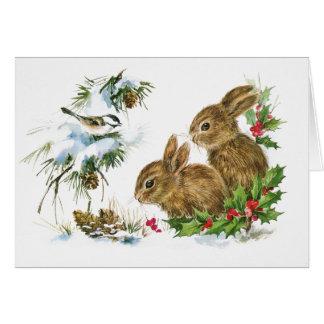 Tarjeta Conejitos lindos en la nieve en el navidad