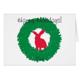 Tarjeta Conejo de conejito del navidad en una guirnalda
