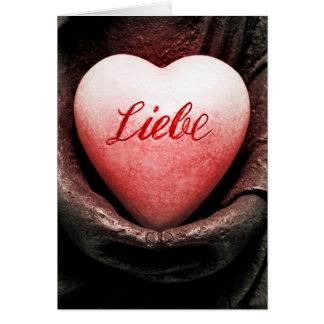 Tarjeta Corazón con palabra amor en Buda mano