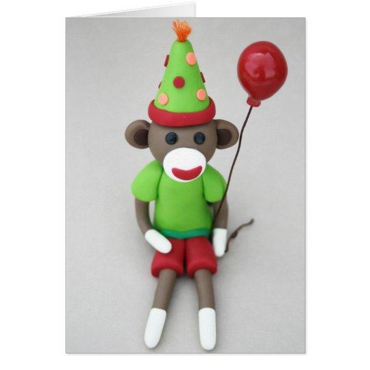 Tarjeta Cumpleaños del mono del calcetín feliz con el