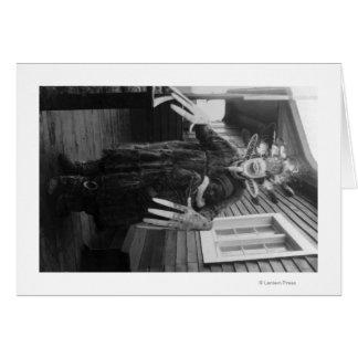 Tarjeta Curandero esquimal y muchacho enfermo en Alaska