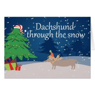 Tarjeta Dachshund a través de la nieve