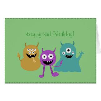 Tarjeta de cumpleaños linda de los monstruos