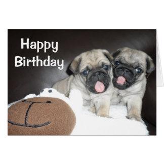 Tarjeta de cumpleaños linda de los perritos del