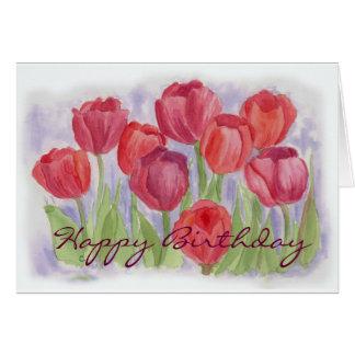 Tarjeta de cumpleaños roja de los tulipanes de la