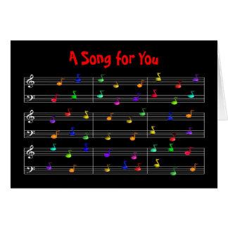 Tarjeta de felicitación colorida de las notas musi