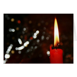 Tarjeta de felicitación de la luz de una vela del