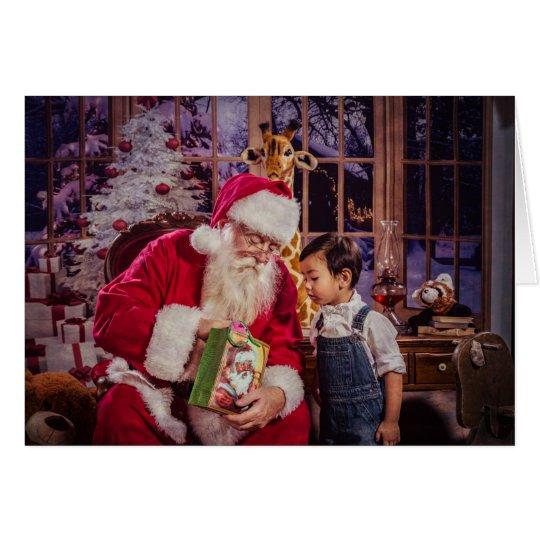 Tarjeta de felicitación del navidad con Santa y el