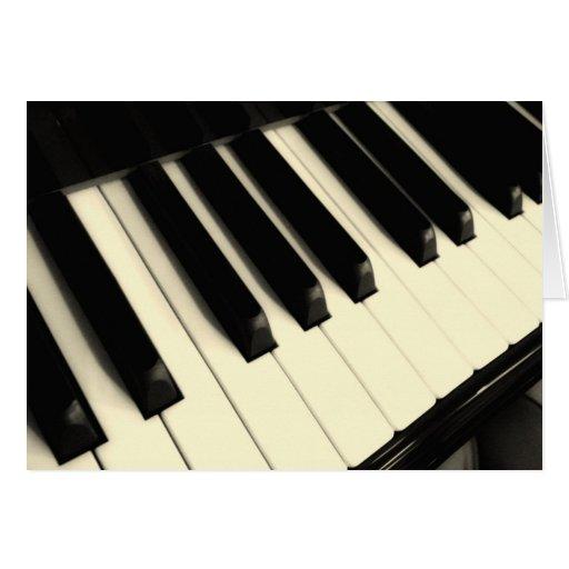 Tarjeta de felicitación dominante del piano